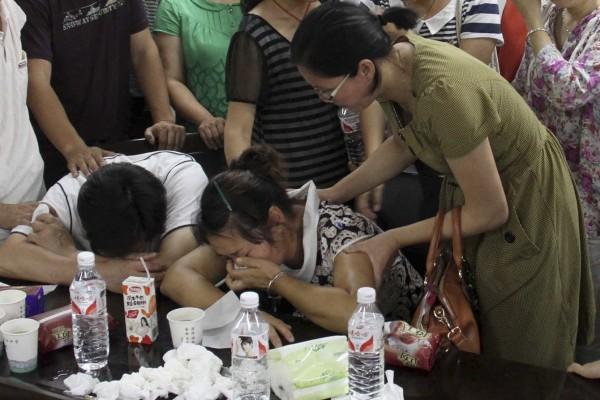 130707-asiana-airlines-crashed-sfo-02-wang-linjia-parents-school-quzhou
