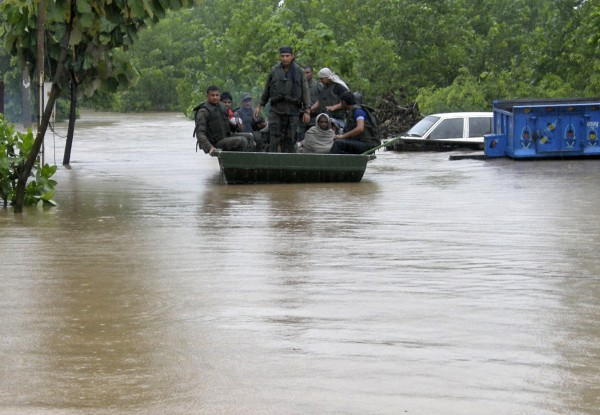 Indian army soldiers rescue stranded villagers in a boat after floods triggered by heavy rains at Odhri village