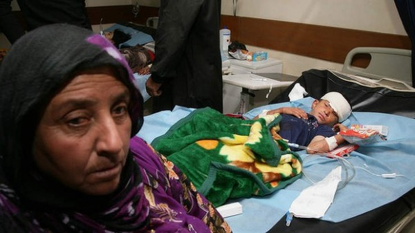 131006-iraq-victim-injured-by-suicide-bombers