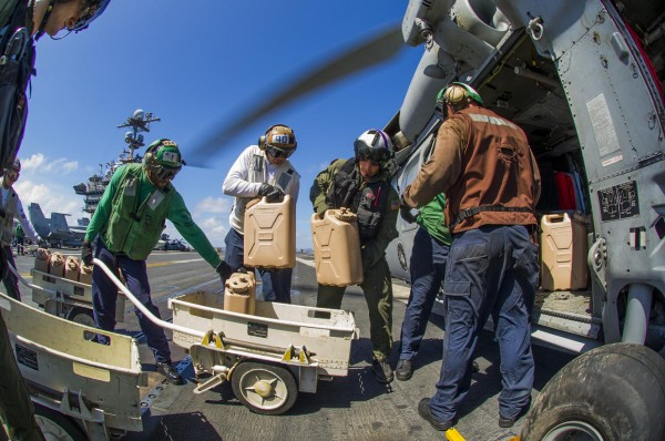 131115-philippines-typhoon-haiyan-USS George Washington aircraft-carrier-Sea Hawk helicopter-07