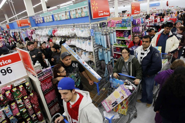 Shoppers line the aisles at WalMart on the Thanksgiving Day holiday in Salem