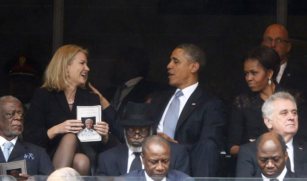 U.S. President Barack Obama shares a laugh with Danish PM Thorning-Schmidt as his wife, U.S. first lady Michelle looks on during a memorial service for late South African President Nelson Mandela in Johannesburg