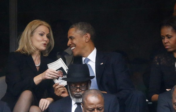 U.S. President Obama shares a laugh with Danish PM Thorning-Schmidt as his wife, U.S. first lady Michelle looks on during a memorial service for late South African President Nelson Mandela in Johannesburg