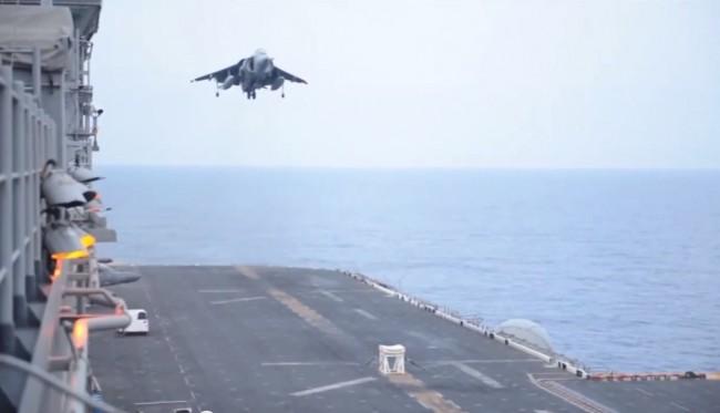 140607- Landing Jet After Gear Malfunction-01
