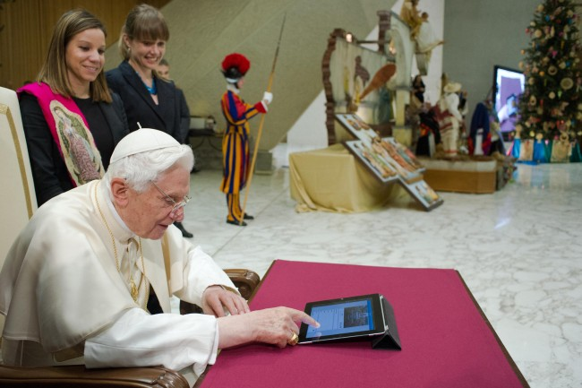 Pope Benedict XVI posts his first tweet using an iPad tablet after his Wednesday general audience in Paul VI's Hall at the Vatican