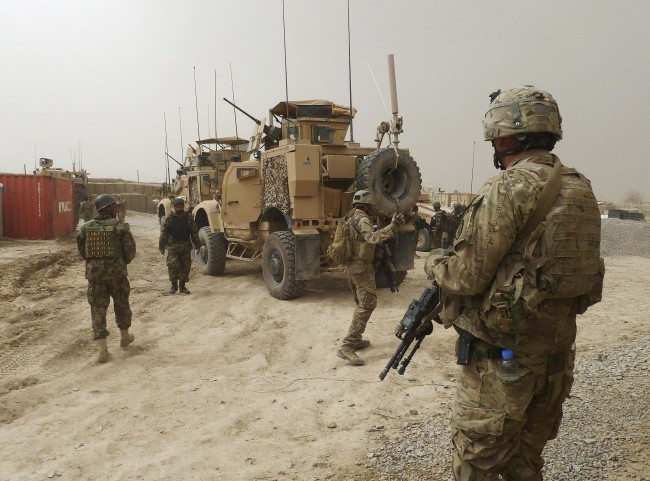 U.S. soldiers keep watch at the entrance of a U.S. base in Panjwai district Kandahar