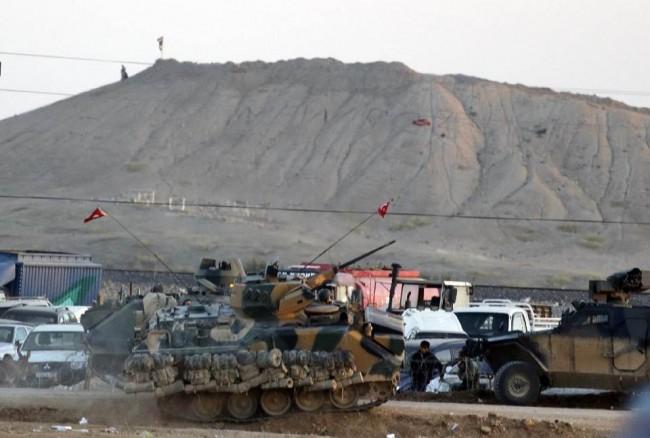 141006-turky-forces-isis-flag-kobani-town