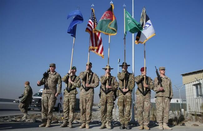 141208-afghanistan-nato-flag-down-war-end-01_resize