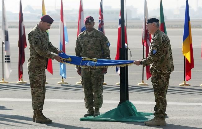 141208-afghanistan-nato-flag-down-war-end-02_resize