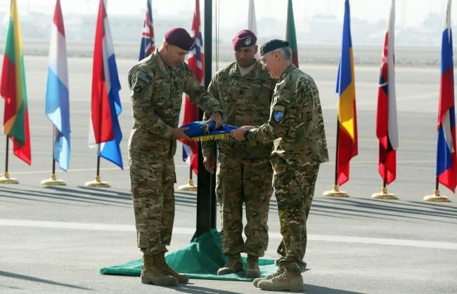 141208-afghanistan-nato-flag-down-war-end-03