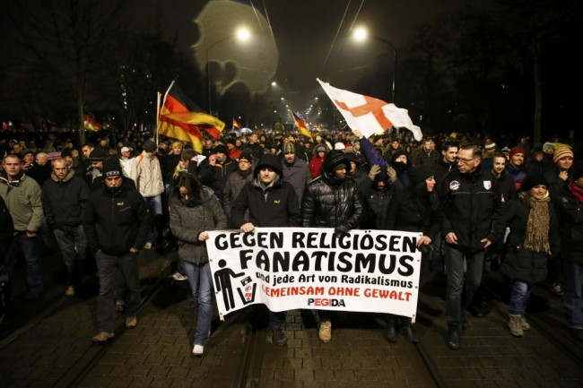 """Participants take part in a demonstration called by anti-immigration group PEGIDA, a German abbreviation for """"Patriotic Europeans against the Islamization of the West"""", in Dresden"""