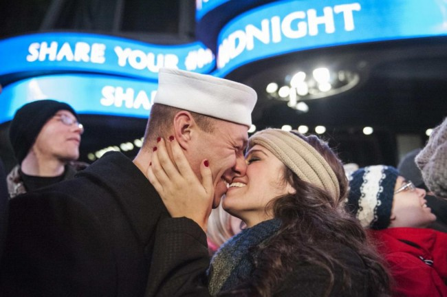Ryan Silipino kisses his girlfriend Lisa Jacobs during New Year's Eve celebrations in Times Square, New York