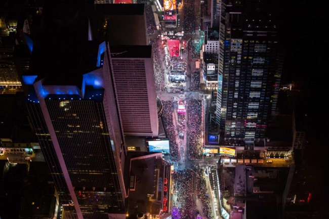 In this aerial image over Midtown, Manhattan, revealers are seen taking part in New Year's Eve celebrations in Times Square, New York