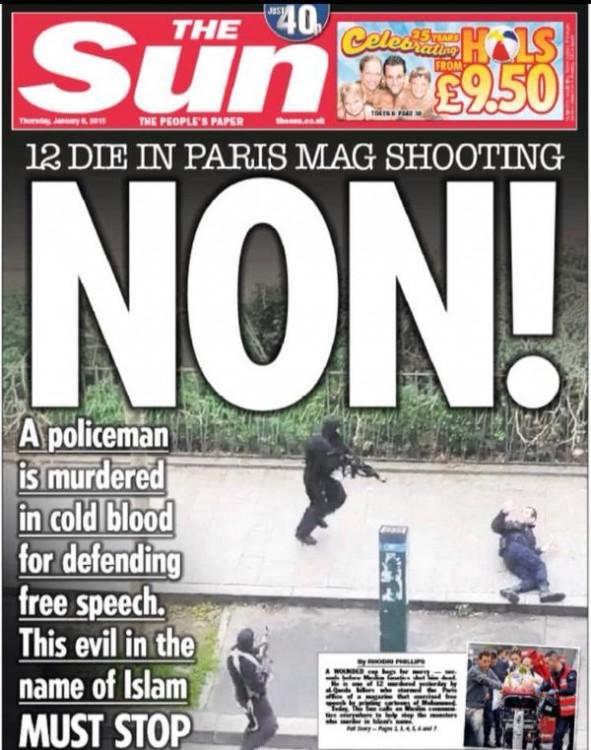150107-newspaper Charlie Hebdo attacked-15
