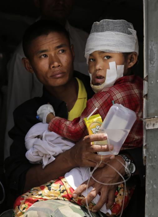 A child injured in Saturday's earthquake, is carried by a Nepalese soldier after being evacuated as they wait to disembark from an Indian Air Force helicopter at the airport in Kathmandu, Nepal, Monday, April 27, 2015. The death toll from Nepal's earthquake is expected to rise depended largely on the condition of vulnerable mountain villages that rescue workers were still struggling to reach two days after the disaster. (AP Photo/Altaf Qadri)