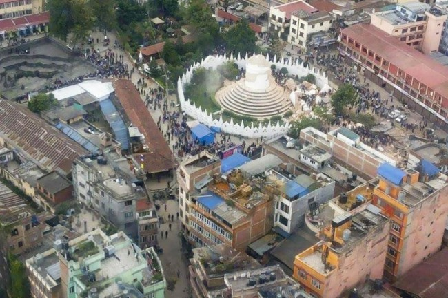 This  aerial photo provided by Shreejan Bhandari, shows the historical Dharahara Tower, a city landmark, destroyed by Saturday's earthquake in Kathmandu, Nepal, Monday, April 27, 2015. A strong magnitude earthquake shook Nepal's capital and the densely populated Kathmandu valley on Saturday devastating the region and leaving tens of thousands shell-shocked and sleeping in streets. (Shreejan Bhandari via AP) MANDATORY CREDIT
