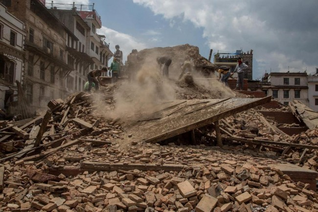 KATHMANDU, NEPAL - APRIL 27:  Volunteers and emergency workers search for bodies buried under the debris of one of the temples at Basantapur Durbar Square on April 27, 2015 in Kathmandu, Nepal. A major 7.8 earthquake hit Kathmandu mid-day on Saturday, and was followed by multiple aftershocks that triggered avalanches on Mt. Everest that buried mountain climbers in their base camps. Many houses, buildings and temples in the capital were destroyed during the earthquake, leaving over 2 thousand dead and many more trapped under the debris as emergency rescue workers attempt to clear debris and find survivors.  (Photo by Omar Havana/Getty Images)
