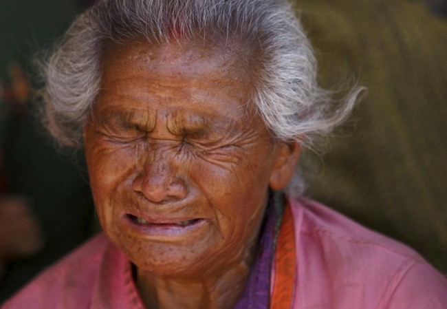 A woman mourns her granddaughter, who died in Saturday's earthquake, in Bhaktapur, Nepal April 27, 2015. REUTERS/Navesh Chitrakar