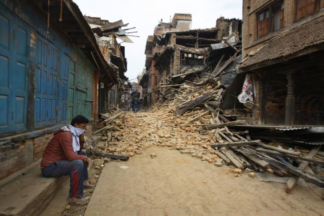 A Nepalese man mourns as he sits near the debris after an earthquake inBhaktapur near Kathmandu, Nepal, Sunday, April 26, 2015. A strong magnitude 7.8 earthquake shook Nepal's capital and the densely populated Kathmandu Valley before noon Saturday, causing extensive damage with toppled walls and collapsed buildings, officials said. (AP Photo/Niranjan Shrestha)