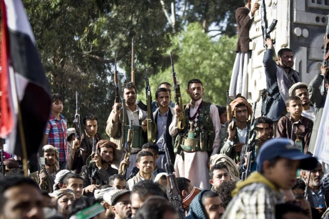 Shiite rebels, known as Houthis, hold up their weapons during a demonstration against an arms embargo imposed by the U.N. Security Council on Houthi leaders, in Sanaa, Yemen, Thursday, April 16, 2015. Al-Qaida's branch in Yemen seized Thursday control of a major airport and sea port and oil terminal in southern Yemen, consolidating their hold of the country's largest province amid wider chaos that is pitting Shiite rebels against forces loyal to the country's exiled president and a Saudi-led air campaign.(AP Photo/Hani Mohammed)