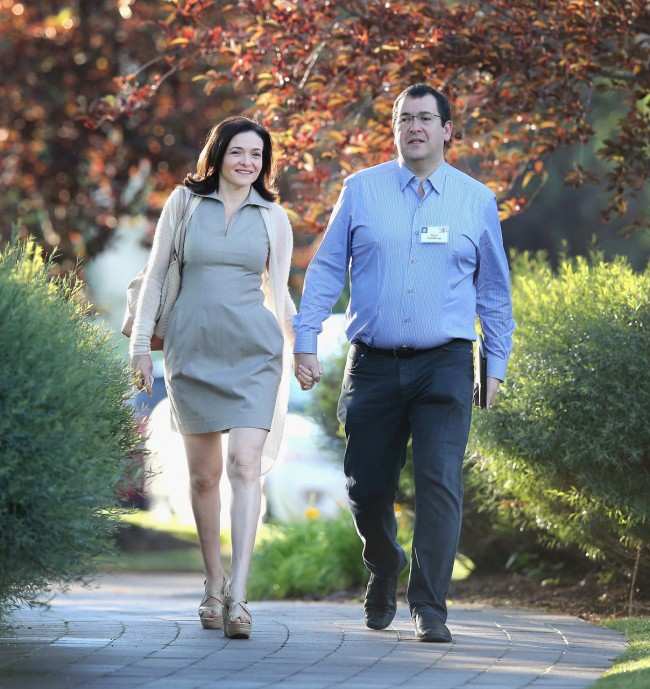 SUN VALLEY, ID - JULY 09:  Sheryl Sandberg, chief operating officer (COO) of Facebook, and her husband David Goldberg, CEO of SurveyMonkey, attend the Allen & Company Sun Valley Conference on July 9, 2014 in Sun Valley, Idaho. Many of the worlds wealthiest and most powerful businessmen from media, finance, and technology attend the annual week-long conference which is in its 32nd year.  (Photo by Scott Olson/Getty Images)