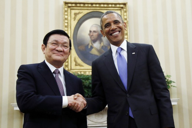 """FILE - In this July 25, 2013, file photo, U.S. President Barack Obama poses with Vietnam's President Truong Tan Sang for a photo during their meeting in the Oval Office at the White House in Washington. Bilateral friendship between the U.S. and Vietnam was formalized in 2013, when Truong Tan Sang visited the White House and with Obama launched a """"Comprehensive Partnership"""" for cooperation in political and diplomatic relations, trade and economic ties, defense, the war legacy and many other issues. (AP Photo/Charles Dharapak, File)"""