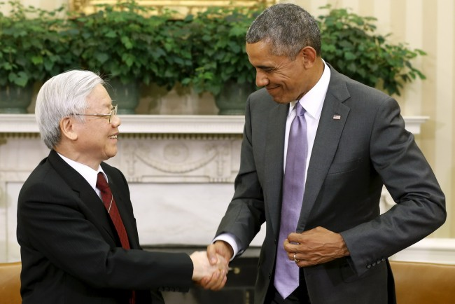 U.S. President Barack Obama (R) shakes hands with Vietnam's Communist Party General Secretary Nguyen Phu Trong following their meeting in the Oval Office at the White House in Washington July 7, 2015. Trong is Vietnam's first party general secretary to visit the U.S., as Hanoi has strengthened its military relationship with former foe Washington since a territorial dispute with Beijing in the South China Sea has heated up in the past couple of years. REUTERS/Jonathan Ernst