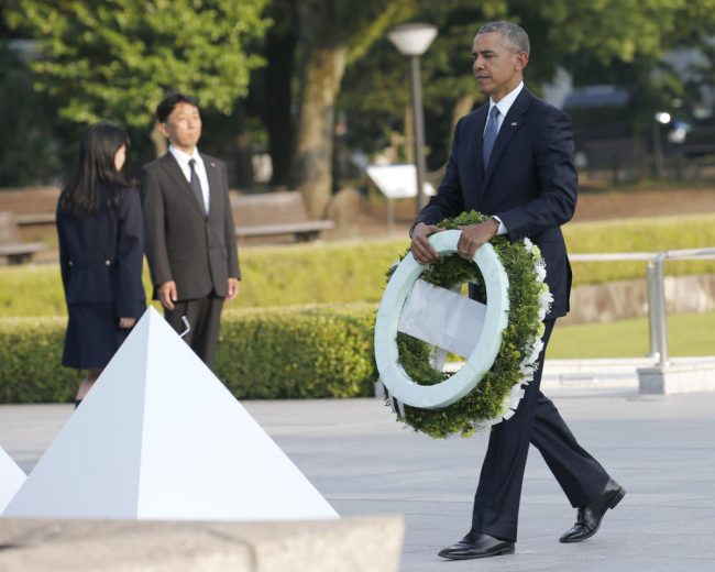 U.S. President Barack Obama walks to lay a wreath at Hiroshima Peace Memorial Park in Hiroshima, western, Japan, Friday, May 27, 2016. Obama on Friday became the first sitting U.S. president to visit the site of the world's first atomic bomb attack, bringing global attention both to survivors and to his unfulfilled vision of a world without nuclear weapons. (AP Photo/Shuji Kajiyama)