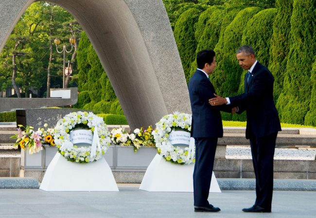 US President Barack Obama (R) and Japanese Prime Minister Shinzo Abe shake hands after laying wreaths at the Hiroshima Peace Memorial Park in Hiroshima on May 27, 2016. Obama on May 27 paid moving tribute to victims of the world's first nuclear attack. / AFP / JIM WATSON (Photo credit should read JIM WATSON/AFP/Getty Images)