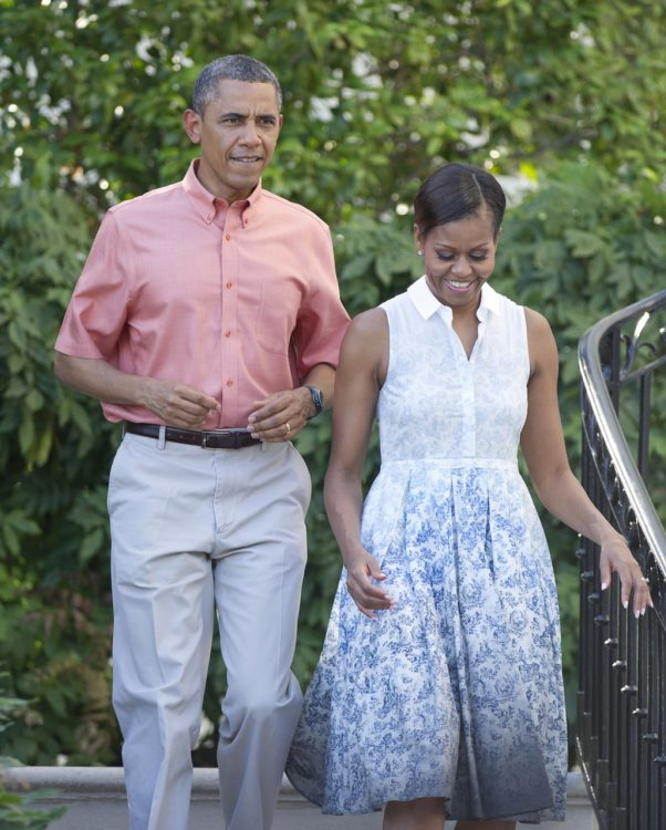 WASHINGTON, DC - JULY 04: U.S. President Barack Obama and first lady Michelle Obama walk down the South Portico stairs to work the rope line as they host a Fourth of July barbecue for military heroes and their families on the South Lawn of the White House on July 4, 2013 in Washington, DC. The president and first lady are hosting members of the military and their families in commemoration of Independence Day. (Photo by Ron Sachs-Pool/Getty Images)