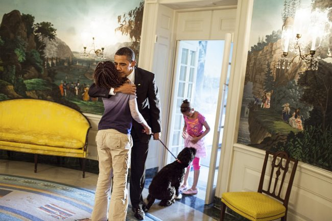 President Barack Obama says goodbye to daughters Sasha and Malia Obama in the Diplomatic Reception Room of the White House before his departure to Arizona, May 13, 209. (Official White House Photo by Samantha Appleton) This photograph is provided by THE WHITE HOUSE as a courtesy and is for one time use only with the MORE Magazine article with First Lady Michelle Obama. This photograph may not be used online or archived. This photograph may not be manipulated in any way and may not otherwise be reproduced, disseminated, or broadcast without the written permission of the White House Photo Office. This photograph may not be used in any commercial or political materials, advertisements, emails, products, promotions that in any way suggests approval or endorsement of the President, the First Family, or the White House.