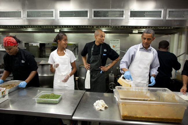 President Barack Obama and daughter Malia Obama participate in a service project to commemorate the September 11th National Day of Service and Remembrance at DC Central Kitchen near the U.S. Capitol in Washington, D.C., Sept. 10, 2011. (Official White House Photo by Pete Souza) This photograph is provided by THE WHITE HOUSE as a courtesy and may be printed by the subject(s) in the photograph for personal use only. The photograph may not be manipulated in any way and may not otherwise be reproduced, disseminated or broadcast, without the written permission of the White House Photo Office. This photograph may not be used in any commercial or political materials, advertisements, emails, products, promotions that in any way suggests approval or endorsement of the President, the First Family, or the White House.