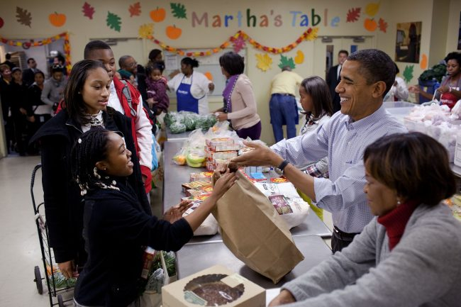 President Barack Obama, First Lady Michelle Obama, daughters Sasha and Malia, and mother-in-law Marian Robinson help distribute Thanksgiving food items at MarthaÕs Table, a food pantry in Washington, D.C., Nov. 24, 2010. (Official White House Photo by Pete Souza)