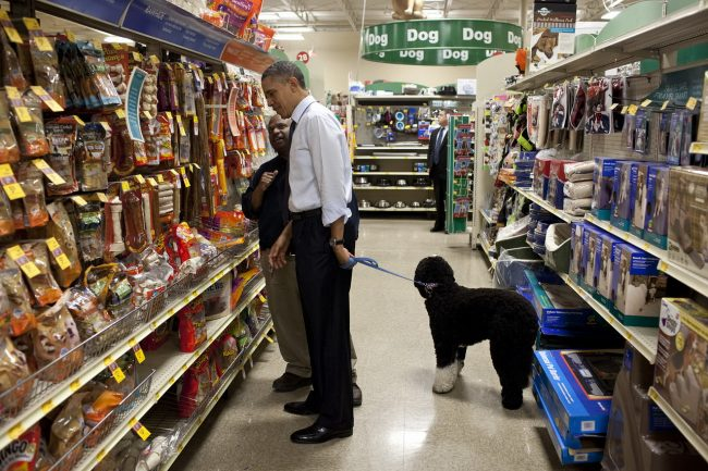 President Barack Obama talks with an employee as he selects a bone for Bo, the Obama family dog, during a stop at a PetSmart store in Alexandria, Va., Dec. 21, 2011. (Official White House Photo by Pete Souza)